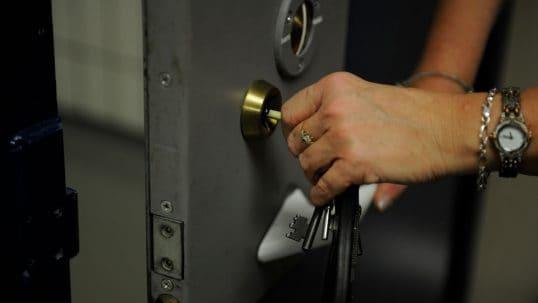 Prison Officer locking cell door