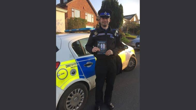Officer with nominated neighbour scheme leaflet