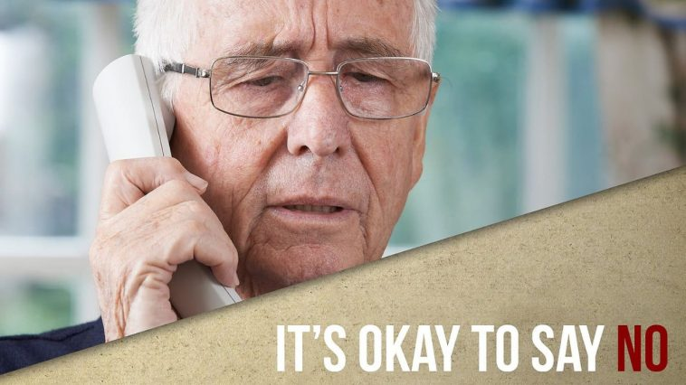 Image shows a man on the phone and the text it's OK to say no