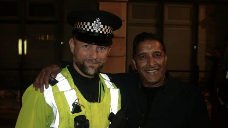 Taxi Cop PC Quinton with a local taxi driver