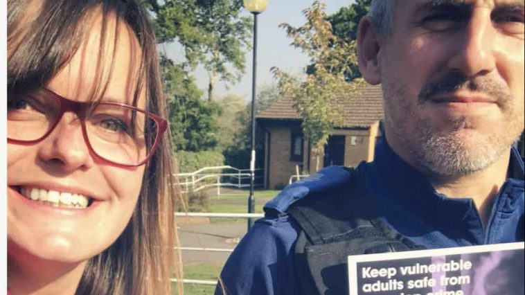 PCSO and woman holding leaflets