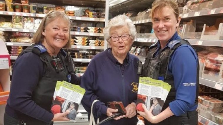 PCSOs with a woman customer in a shop