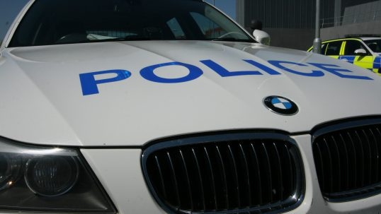 Stock image of marked police car.