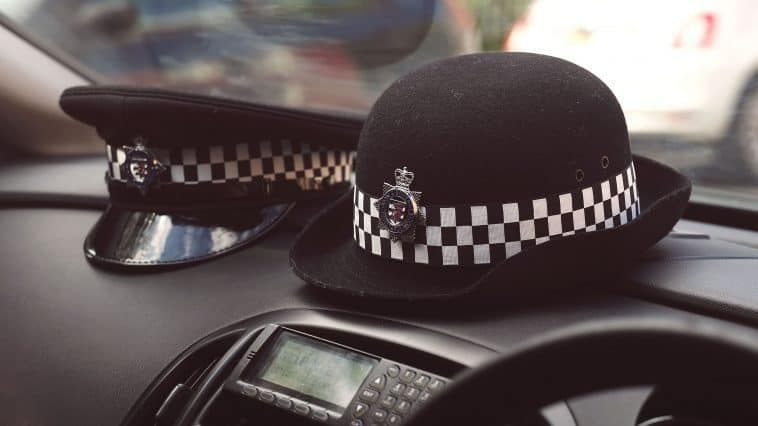 Police officers hats on car dashboard