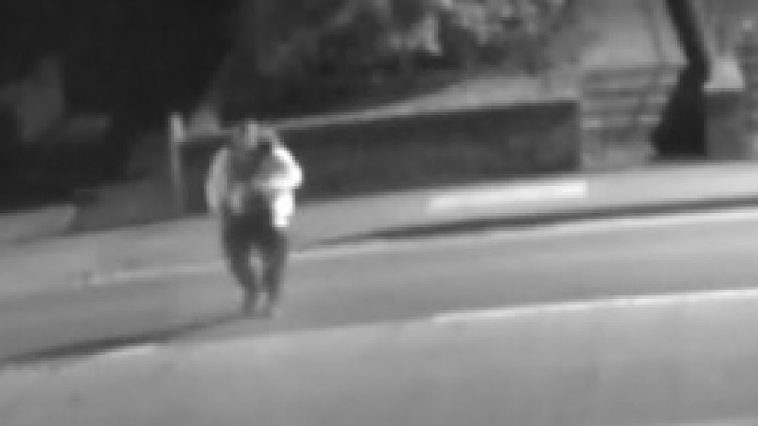 CCTV image of a man with a white jacket