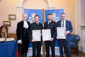 PC Luke O'Connell, PC Philip Sage and Insp Glen Boxer recieving the Crown Court Commendation from High Sheriff of Bristol, Charles Wyld.