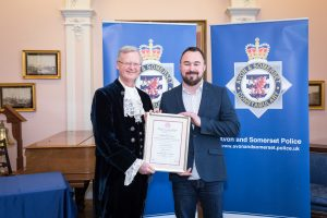 Robert Stockwell recieving the Royal Humane Award from High Sheriff of Bristol, Charles Wyld.