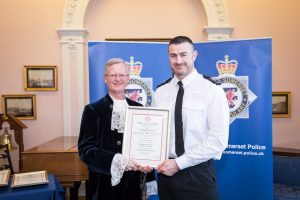 Special Constable Matthew Carter recieving the Royal Humane Award from High Sheriff of Bristol, Charles Wyld.