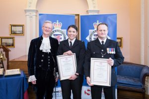 PC Hannah Baynam, PC Simon Weeks recieving the Royal Human Award from High Sheriff of Bristol, Charles Wyld.