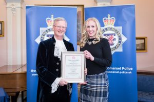 Sarah Heywood recieving the Royal Humane Award from High Sheriff of Bristol, Charles Wyld.