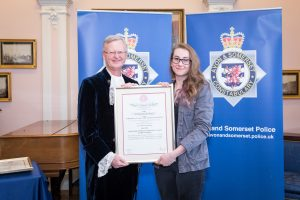 Jessica Dyer recieving the Royal Humane Award from High Sheriff of Bristol, Charles Wyld