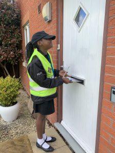 Year 5 student posts leaflet through door in Stockmoor