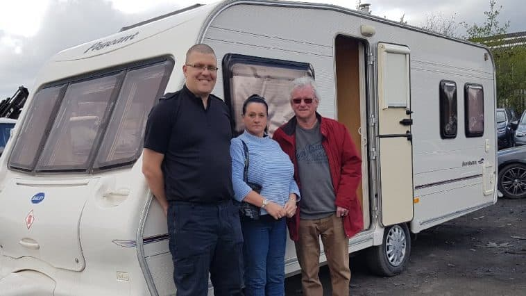 Image of PC Calderwood with Mrand Mrs Collison and their caravan