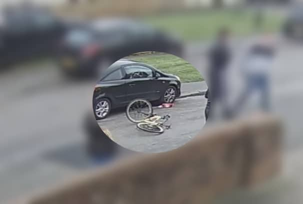 CCTV still of the bicycle in the road