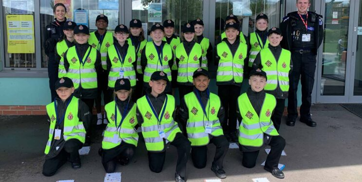 Somerset Bridge School Mini Police, with PCSOs Ella (left) and Jack (right)