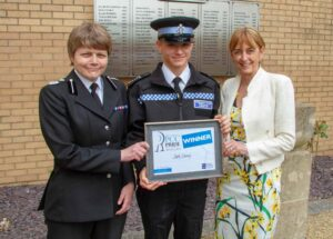 Cadet Josh Davies with Deputy Chief Constable Sarah Crew (left) and the PCC (right).