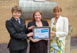 Linda Cunningham with Deputy Chief Constable Sarah Crew (left) and the PCC (right).