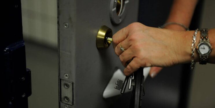 Officer locking cell door