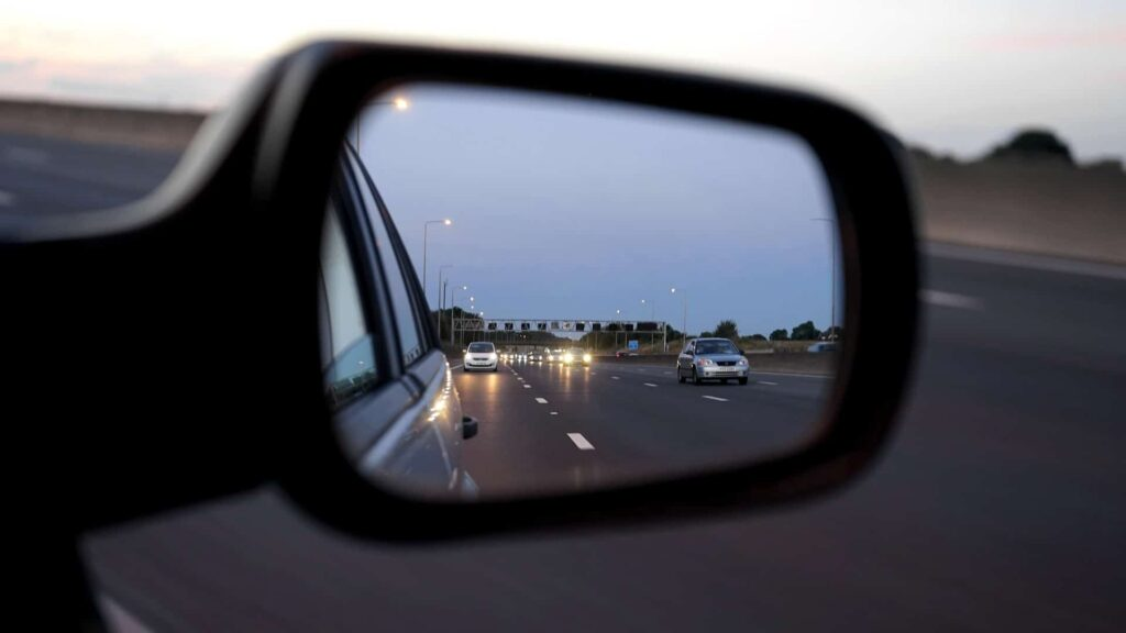 Traffic in car mirror