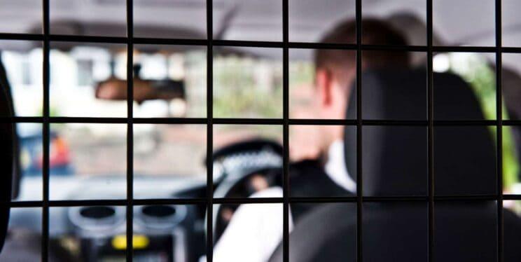 Police officer sat in police car