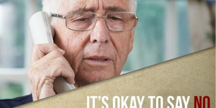 Man on the phone with text it's OK to say no