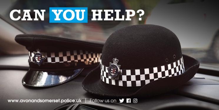 Police hats on a car dashboard