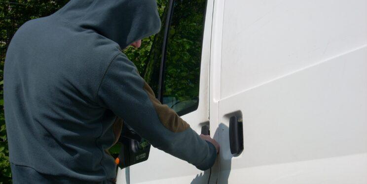 Stock image of man by van door