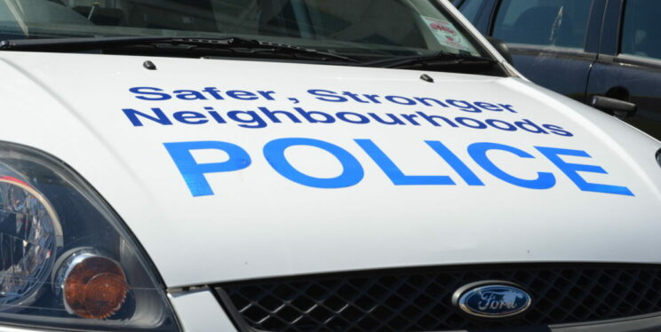 Neighbourhood Police on marked car bonnet