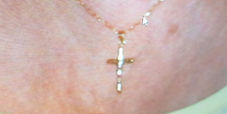 a cross on a gold chain