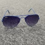 A pair of blue Ray Ban aviator sunglasses