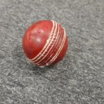 A red hard cricket ball