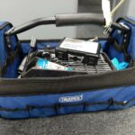 A blue draper tool box with spanner set in it.