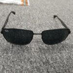 A picture of a pair of black Ray Ban sunglasses