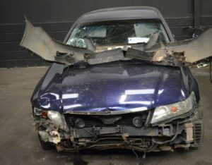 A picture of a written off blue car