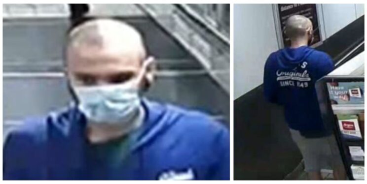CCTV image of man in blue hoodie