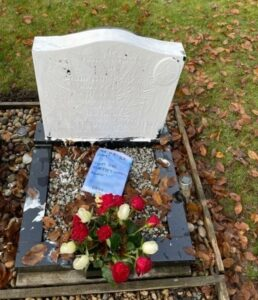 The white paint covering the gravestone and one of the offensive notes